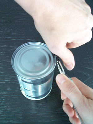 A standard tin opener is completely right handed